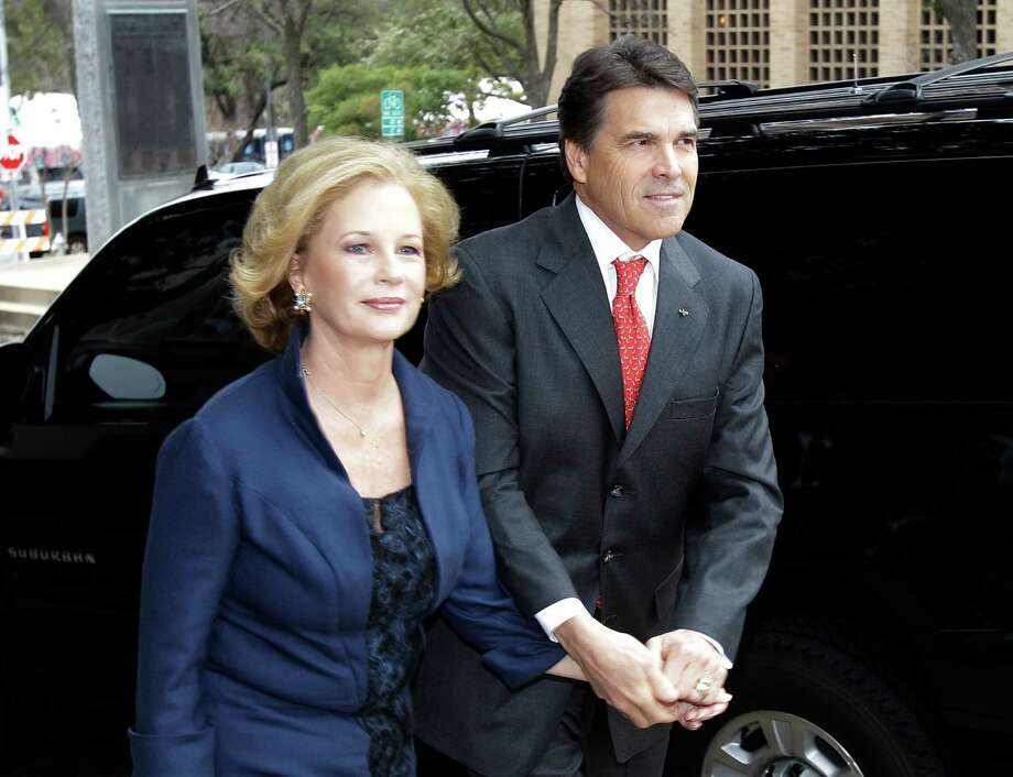 Gov. Rick Perry and his wife, Anita arrive for a church service prior to his inauguration, Tuesday, Jan. 18, 2011, in Austin. Photo: Eric Gay, STF / AP2011