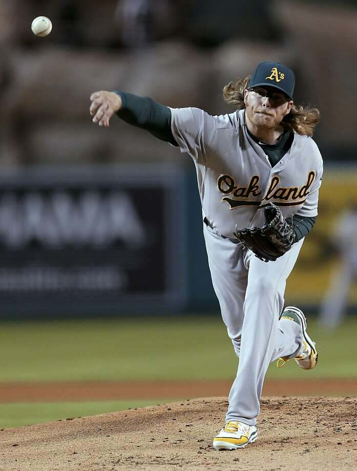 Elbow tendinitis cost A.J. Griffin a start in the ALDS, but he hopes to return if the A's advance. Photo: Chris Carlson, Associated Press