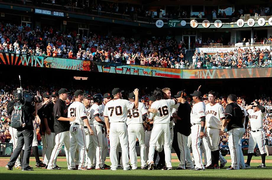 As the Giants celebrated their win over the Padres on the season's final day, 2014 plans were being made. Photo: Brian Bahr, Getty Images