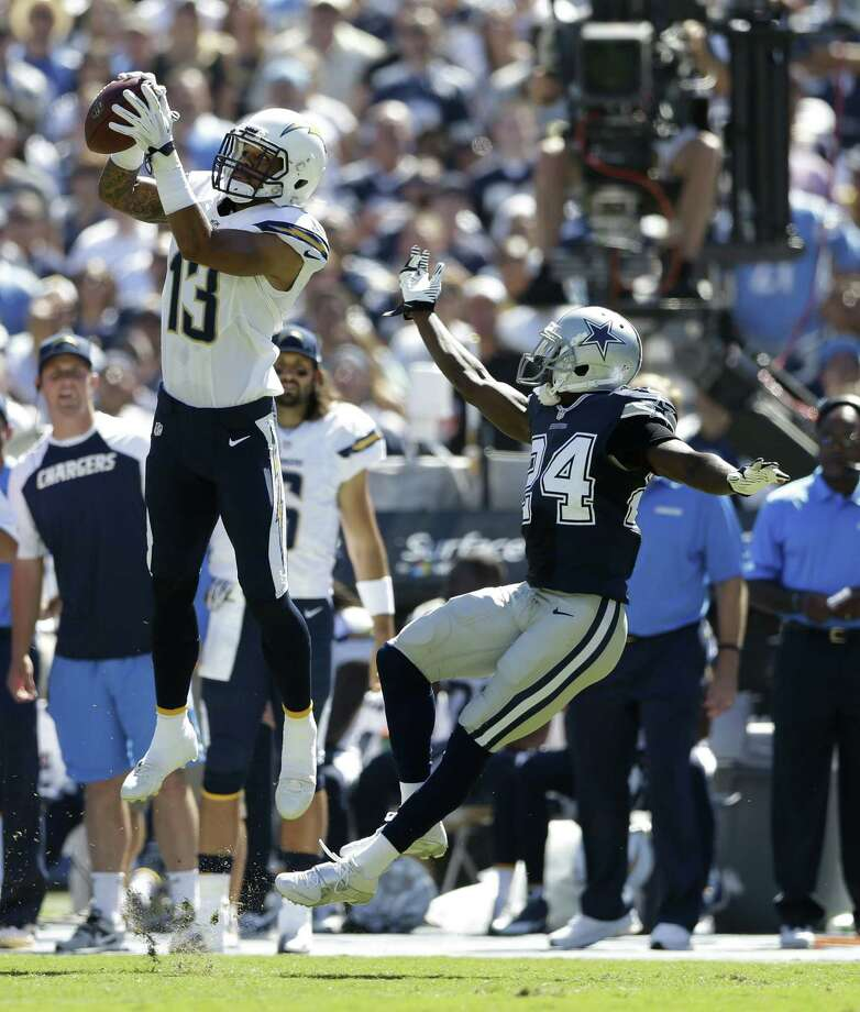 The Chargers' Keenan Allen catches a pass Sunday in front of the Cowboys' Morris Claiborne, who was picked on all game by San Diego's aerial attack. Photo: Gregory Bull / Associated Press