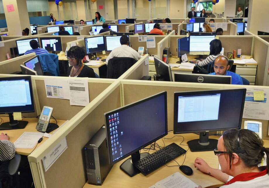 Customer service specialists man the Maximus call center for NY State of Health as it launches local healthcare exchange enrollment Tuesday, Oct. 1, 2013, at their customer service center in Albany, N.Y.  (John Carl D'Annibale / Times Union) Photo: John Carl D'Annibale / 00024066A
