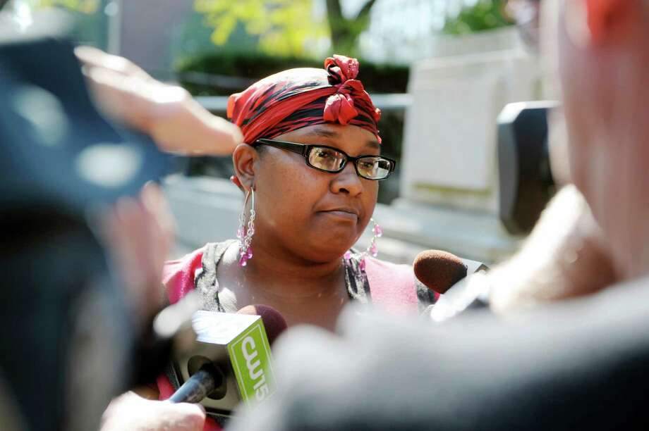 Keila Nelligan, the mother of  Sha'hiim Nelligan, talks to members of the media outside the Schenectady County Courthouse on Tuesday, Oct. 1, 2013 in Schenectady, NY.  Keila's mother, Gloria Nelligan, was found guilty in the beating death of 8-year-old Sha'hiim.   (Paul Buckowski / Times Union) Photo: Paul Buckowski / 00024064A