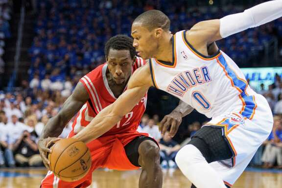 Oklahoma City Thunder point guard Russell Westbrook (0) steals the ball from Houston Rockets point guard Patrick Beverley (12) during the first half of Game 2 of a Western Conference first-round playoff series at Chesapeake Arena on Wednesday, April 24, 2013, in Oklahoma City. ( Smiley N. Pool / Houston Chronicle )
