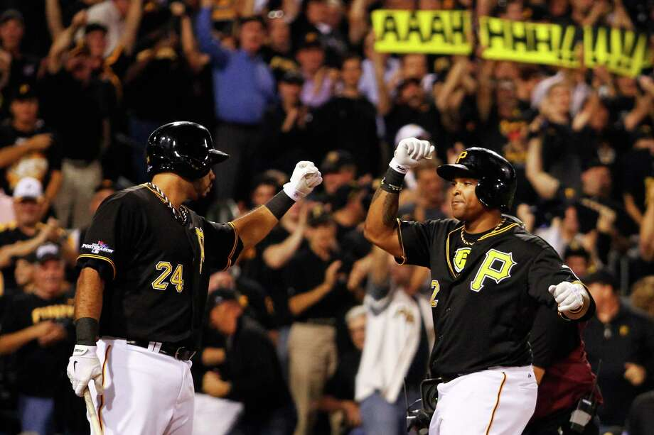 PITTSBURGH, PA - OCTOBER 01:  Marlon Byrd #2 celebrates his second inning home run with Pedro Alvarez #24 of the Pittsburgh Pirates during their National League Wild Card game against the Cincinnati Reds at PNC Park on October 1, 2013 in Pittsburgh, Pennsylvania.  (Photo by Justin K. Aller/Getty Images) ORG XMIT: 182983146 Photo: Justin K. Aller / 2013 Getty Images
