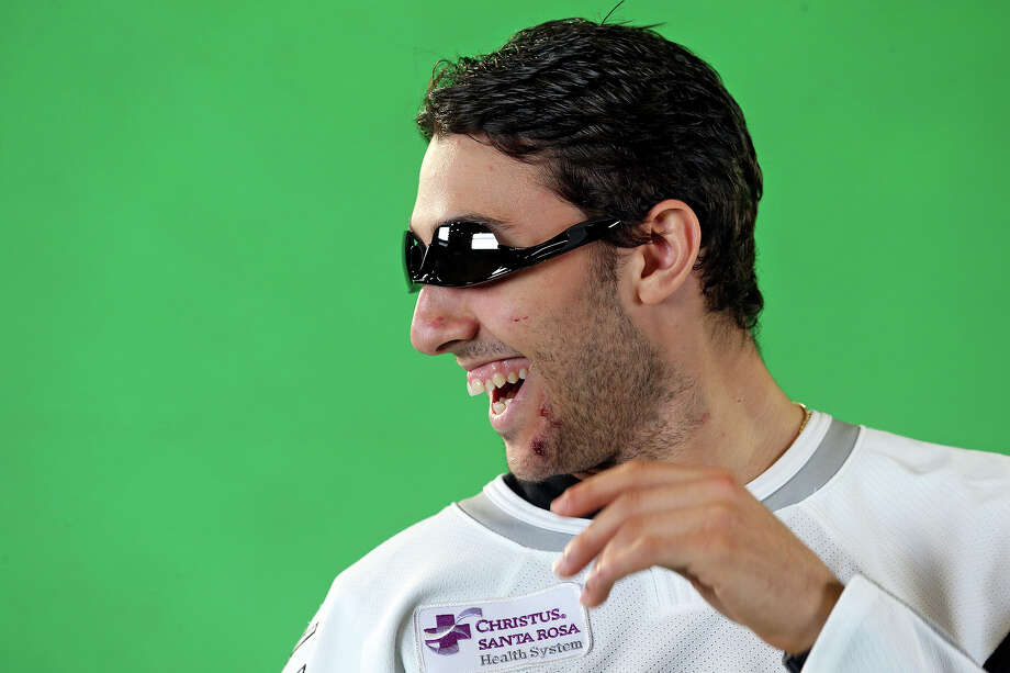 Vincent Trocheck fits a pair of sunglasses upside down as the Rampage hockey team conducts media day at the AT&T Center  on October 1, 2013 Photo: Tom Reel, San Antonio Express-News