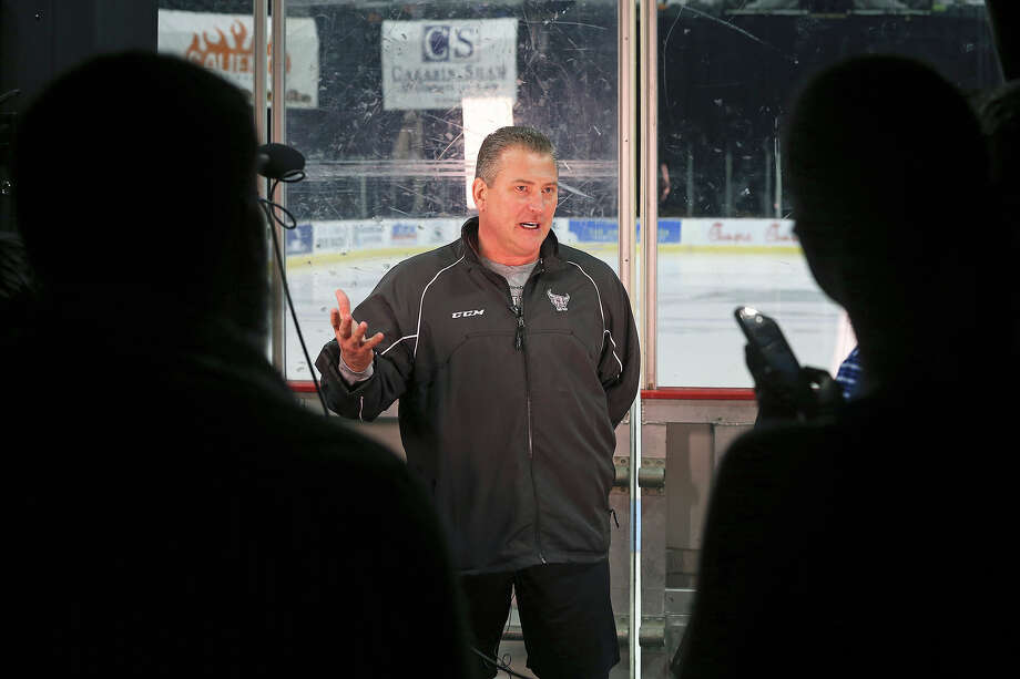 Coach Peter Horachek talks on camera with the ice rink in the background as the Rampage hockey team conducts media day at the AT&T Center  on October 1, 2013 Photo: Tom Reel, San Antonio Express-News