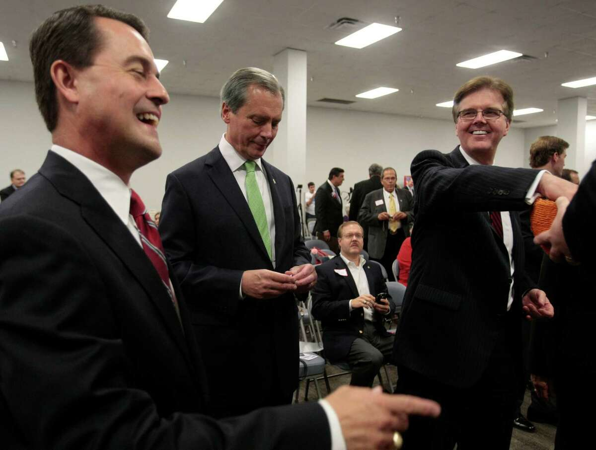 Candidates for Texas Lt. Governor, Agriculture Commissioner Todd Staples, Lt. Gov. David Dewhurst, and State Sen. Dan Patrick, pull pieces of paper to see who will go first during their debate Tuesday in Houston.