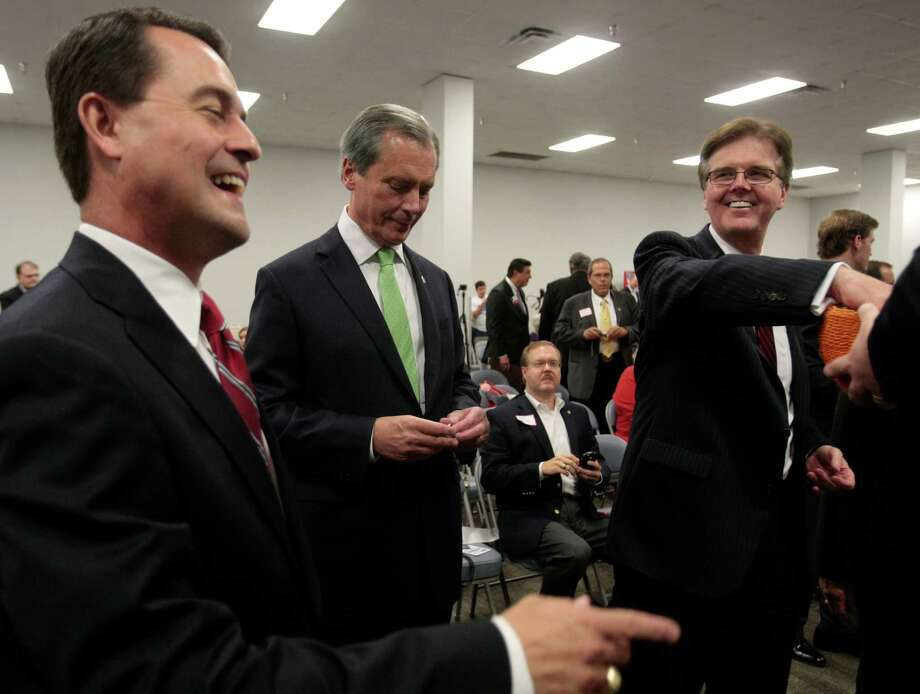 Candidates for Texas Lt. Governor, Agriculture Commissioner Todd Staples, Lt. Gov. David Dewhurst, and State Sen. Dan Patrick, pull pieces of paper to see who will go first  during their debate Tuesday in Houston. Photo: Billy Smith II, Staff / © 2013 Houston Chronicle