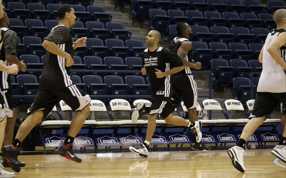 Tony Parker (middle), who had a busy offseason, runs downcourt during a workout at Spurs training camp in Colorado Springs.