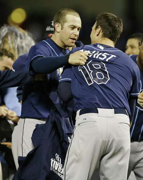 Tampa Bay's Evan Longoria (left) and Ben Zobrist celebrate their tiebreaker victory over the Rangers. Photo: Tony Gutierrez / Associated Press