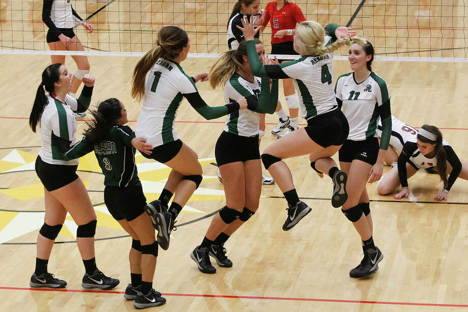 The Reagan Lady Rattlers celbrate a point during the fourth and final set of their match with Churchill at Littton Gym on Tuesday, Oct. 1, 2013. Reagan won the match 3-1.  MARVIN PFEIFFER/ mpfeiffer@express-news.net Photo: Marvin Pfeiffer, San Antonio Express-News / Express-News 2013
