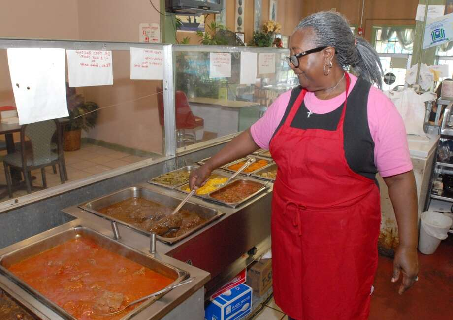 Mary Richard, 70, of Beaumont, checks on her hamburger steaks Wednesday, March 23, 2011, at Richard's Cafe on Magnolia Ave in Beaumont. Richard opened Richard's Cafe with her family in the early 90's when they moved back to the area. The cafe started in Kountze, moved to College Street in Beaumont and then to the present Magnolia location.  Scott Eslinger/cat5 Photo: Scott Eslinger/cat5