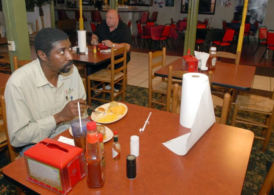 Alex Jones, 47, of Port Arthur, watches the news as he eats lunch at Richard's Cafe on Magnolia Ave in Beaumont on Wendesday, March 23, 2011. Scott Eslinger/cat5 Photo: Scott Eslinger/cat5