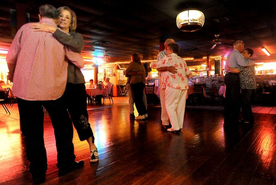 Patrons slow dance at Larry's French Market and Cajun Cafeteria in Groves, Thursday, October 13, 2011. Tammy McKinley/The Enterprise