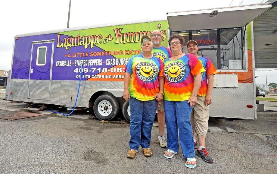 From left to right; Robin Cappel, Davis Smith, Cyd Cappel, and Megan Stelly stand outside the Lagniappe at Yummo's food truck at 5213 Twin City Highway in Port Arthur. Open 11 a.m. - 6 p.m. Tuesday - Thursday and 11 a.m. - 7 p.m. Friday and Saturday. Photo taken: Randy Edwards/The Enterprise