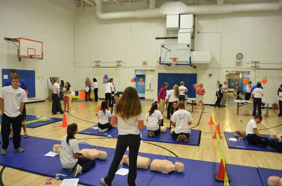 Members of Post 53 took part in Hands For Life  at the Darien YMCA on Sept. 29 to train community members how to use hands-only CPR. In total, the ambulance corps trained 904 people. Each year, nearly 785,000 Americans suffer from a heart attack and less than one in four receive CPR from a bystander, and only about 5 percent of cardiac arrest victims survive. Studies show that survival rates fall 10% each minute without CPR before emergency medical assistance, often with a fatal outcome. Photo: Megan Spicer