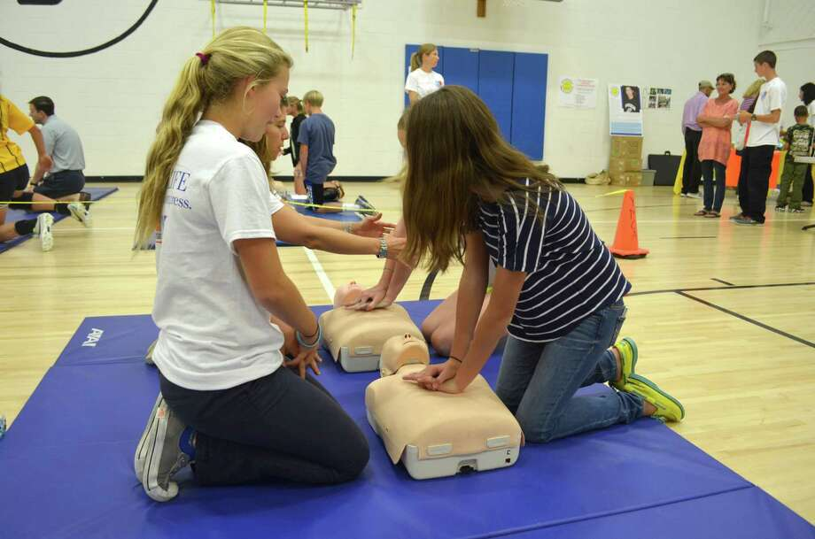 Members of Post 53 took part in Hands For Life  at the Darien YMCA on Sept. 29 to train community members how to use hands-only CPR. It only took 15 minutes to train each person. Photo: Megan Spicer