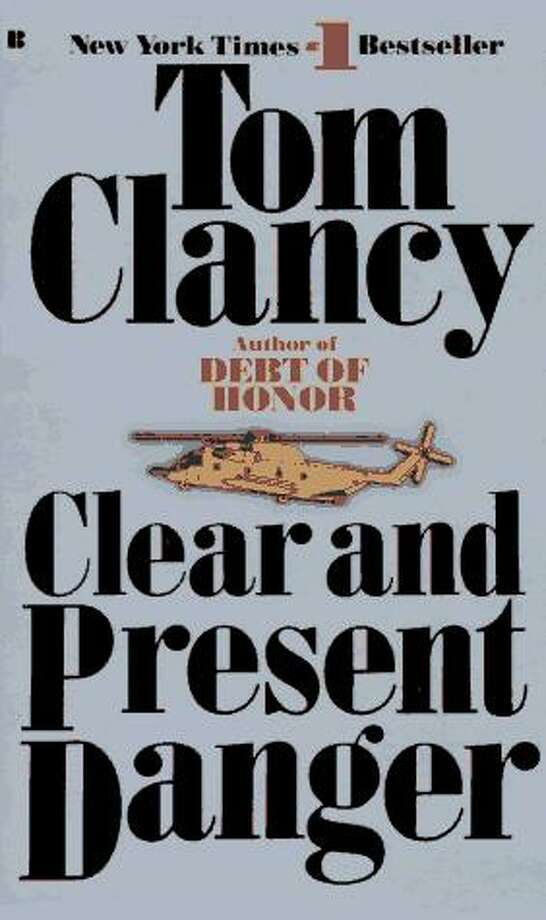"Clear and Present Danger (1989) The President authorizes the CIA to use American military forces in a covert war against cocaine producers in Colombia. The operation is betrayed. Ryan meets John Clark as they lead a mission to rescue abandoned soldiers. Domingo ""Ding"" Chavez (Clark's protege in later novels) is one of the rescued soldiers. The 1994 film stars Harrison Ford as Ryan, Willem Dafoe as Clark, and Raymond Cruz as Chavez."