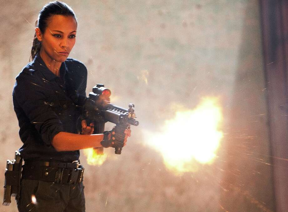 "Zoe Saldaña is revenge incarnate with a bazooka in ""Colombiana."" She's a combination of sweetness and destruction while blasting away the bad guys with high-powered weaponry. Photo: TriStar Pictures"