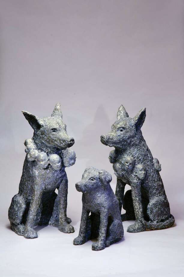 """""""Dog Is Good,"""" an exhibit by Damon J. Thomas, examines the relationship between man and dog. Photo: Courtesy Photo"""