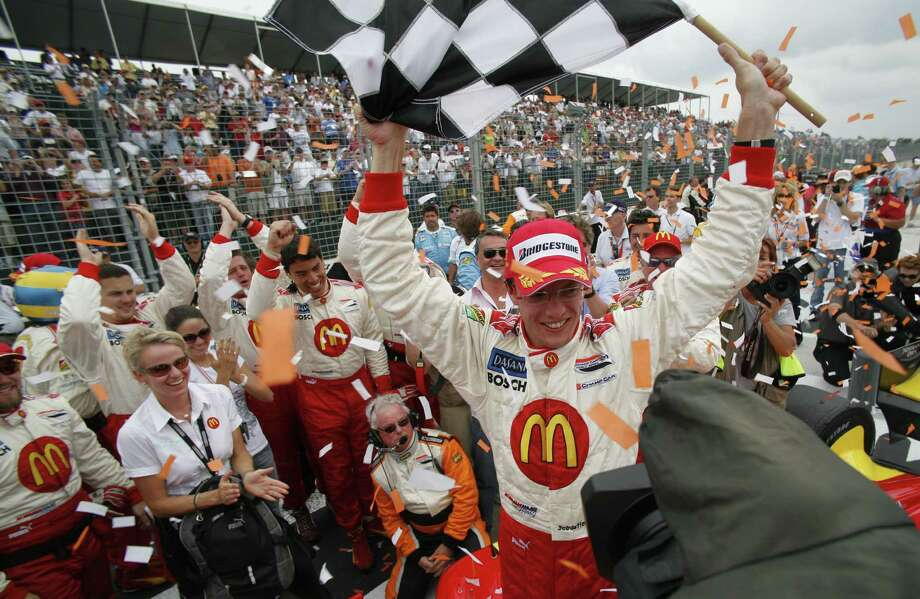 Sebastien Bourdais waves the checkered flag after winning the Grand Prix of Houston  in 2007.  Bourdais hopes to return to  victory lane this weekend. Photo: Steve Ueckert, Staff Photographer / Houston Chronicle