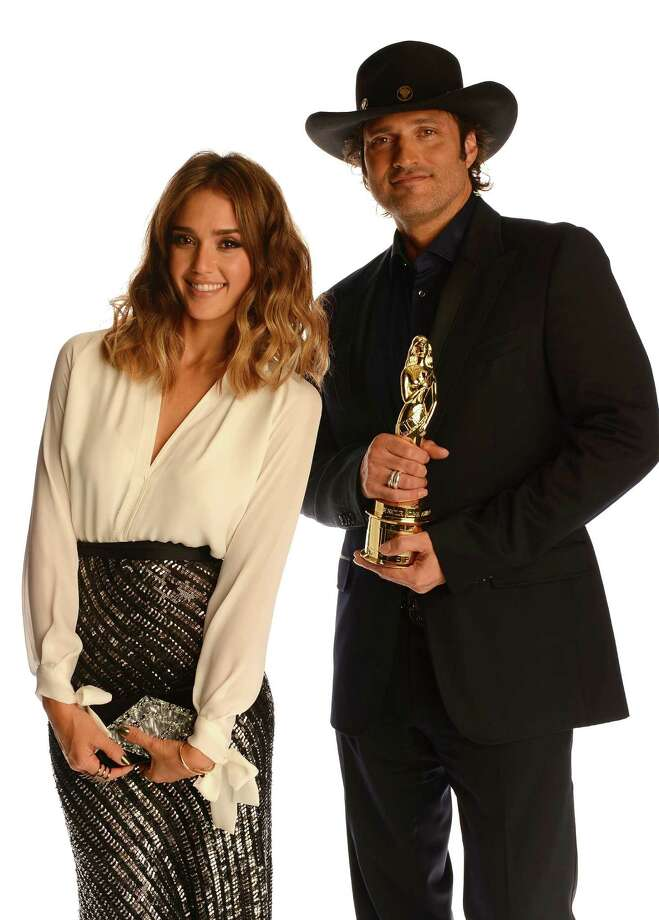 Actress Jessica Alba (left) and director Robert Rodriguez, holding the NCLR's Anthony Quinn Award for Industry Excellence. Photo: Getty Images For NCLR