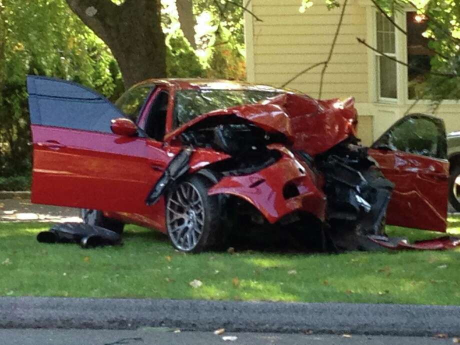 Bartosz Kurpieki, 23, of Taylor St., Stamford was charged with reckless driving and operating a motor vehicle without a license after crashing a borrowed 2011 BMW M3 into a tree on Westover Road Tuesday afternoon. Kurpieki sustained injuries to his hand and wrist while a female passenger suffered head and abdominal injuries, according to police. Photo: Contributed Photo