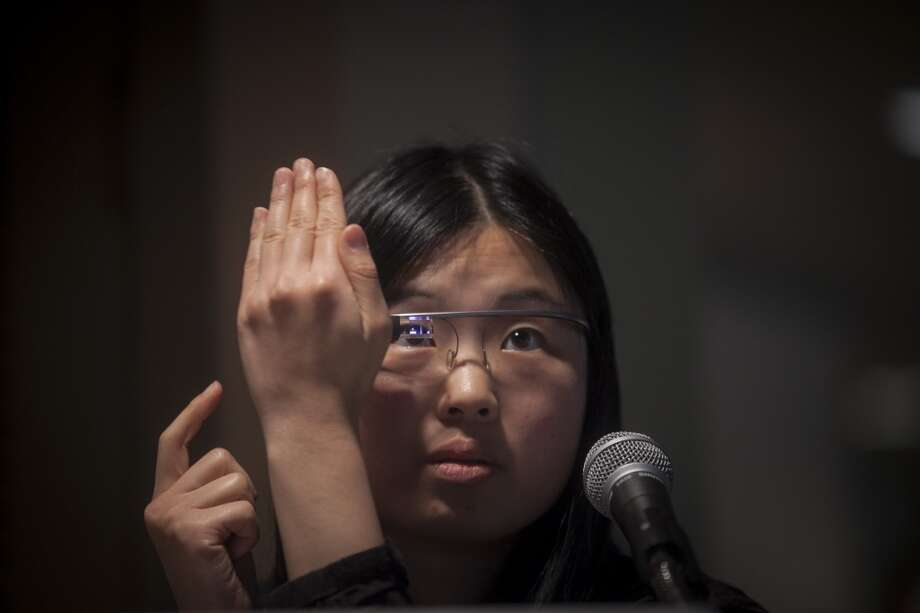 Tech freelancer Yosun Chang shows off a Google Glass hack that turns Google Glass into a piano or trumpet by using the optical display to virtually represent the instruments which can then be interacted with by moving your hands and head at the SF Music Tech summit  in San Francisco on October 1st 2013. Photo: Special To The Chronicle
