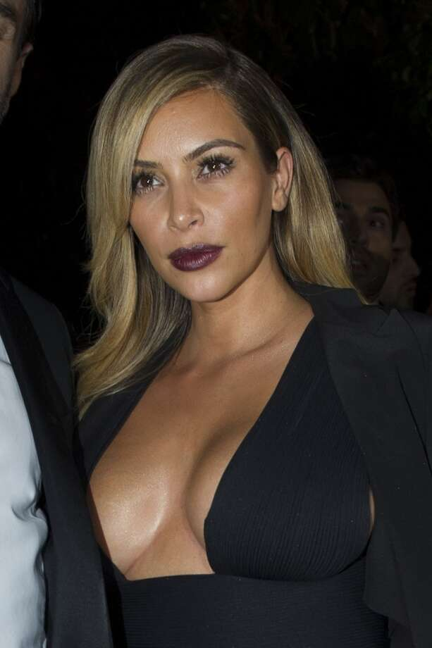 Kim Kardashian arrives to attend the Mademoiselle C Fashion Week VIP Screening after party, in Paris, Tuesday, Oct.1, 2013. (AP Photo/Zacharie Scheurer) Photo: Zacharie Scheurer, Associated Press