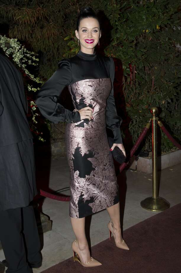Katy Perry poses for the photographers as she arrives to attend the Mademoiselle C Fashion Week VIP Screening after party, in Paris, Tuesday, Oct.1, 2013. (AP Photo/Zacharie Scheurer) Photo: Zacharie Scheurer, Associated Press