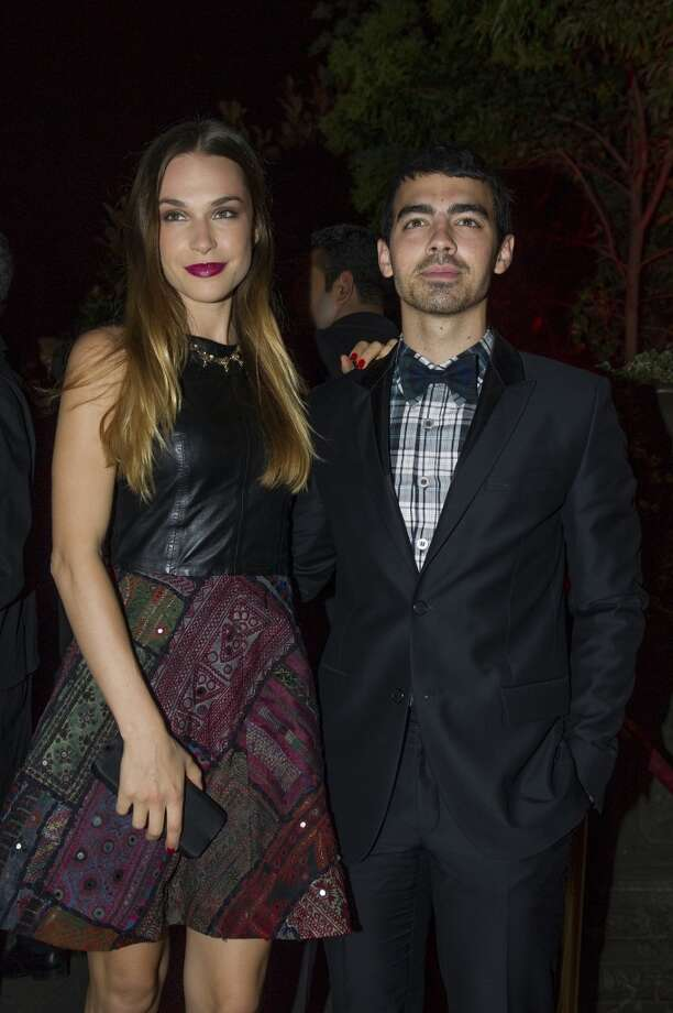 Joe Jonas and Blanda Eggenschwiler are posing for the photographers as they arrive to attend the Mademoiselle C Fashion Week VIP Screening after party, in Paris, Tuesday, Oct.1, 2013. (AP Photo/Zacharie Scheurer) Photo: Zacharie Scheurer, Associated Press