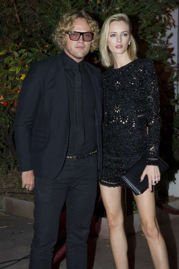 Designer  Peter Dundas and Russian model Daria Strokous  are posing for the photographers as they arrive to attend the Mademoiselle C Fashion Week VIP Screening after party, in Paris, Tuesday, Oct.1, 2013. (AP Photo/Zacharie Scheurer) Photo: Zacharie Scheurer, Associated Press