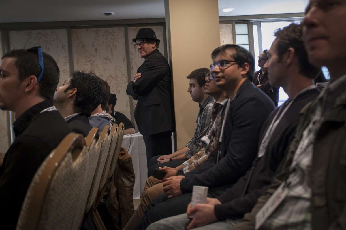 Audience members during a presentation by tech freelancer Yosun Chang where she shows off a Google Glass hack that turns Google Glass into a piano or trumpet by using the optical display to virtually represent the instruments which can then be interacted with by moving your hands and head at the SF Music Tech summit in San Francisco on October 1st 2013.