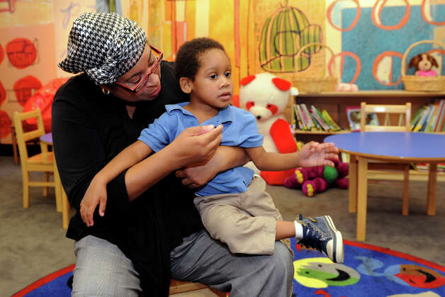 Melanie Rhodes holds her son, Malachi, 3, during an interview at ABCD Inc., in Bridgeport, Conn. Oct. 2, 2013. Malachi is enrolled in the agencyâÄôs federally funded Head Start program, which has closed due to the Congressional impasse and government shutdown. Photo: Ned Gerard / Connecticut Post