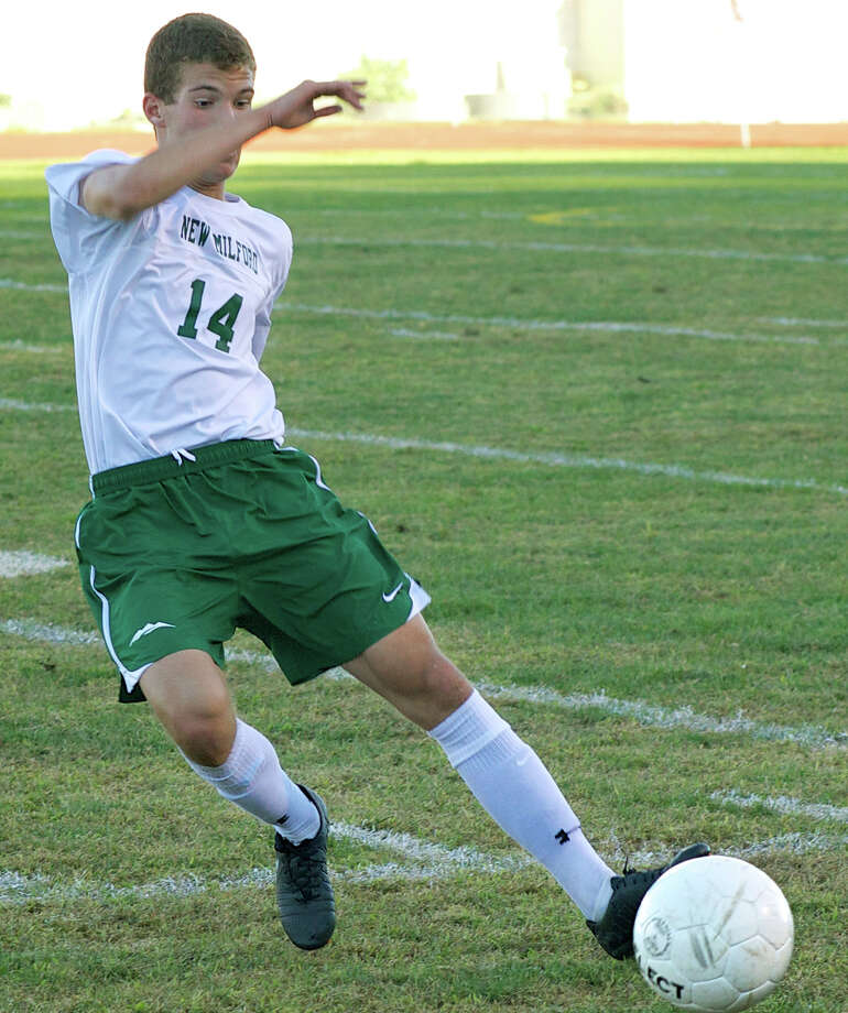 The Green Wave's Adrian Lekaj found the range for two goals during New Milford High School boys' soccer's 3-1 victory over Stratford, Sept. 23, 2013 at NMHS. Photo: Trish Haldin
