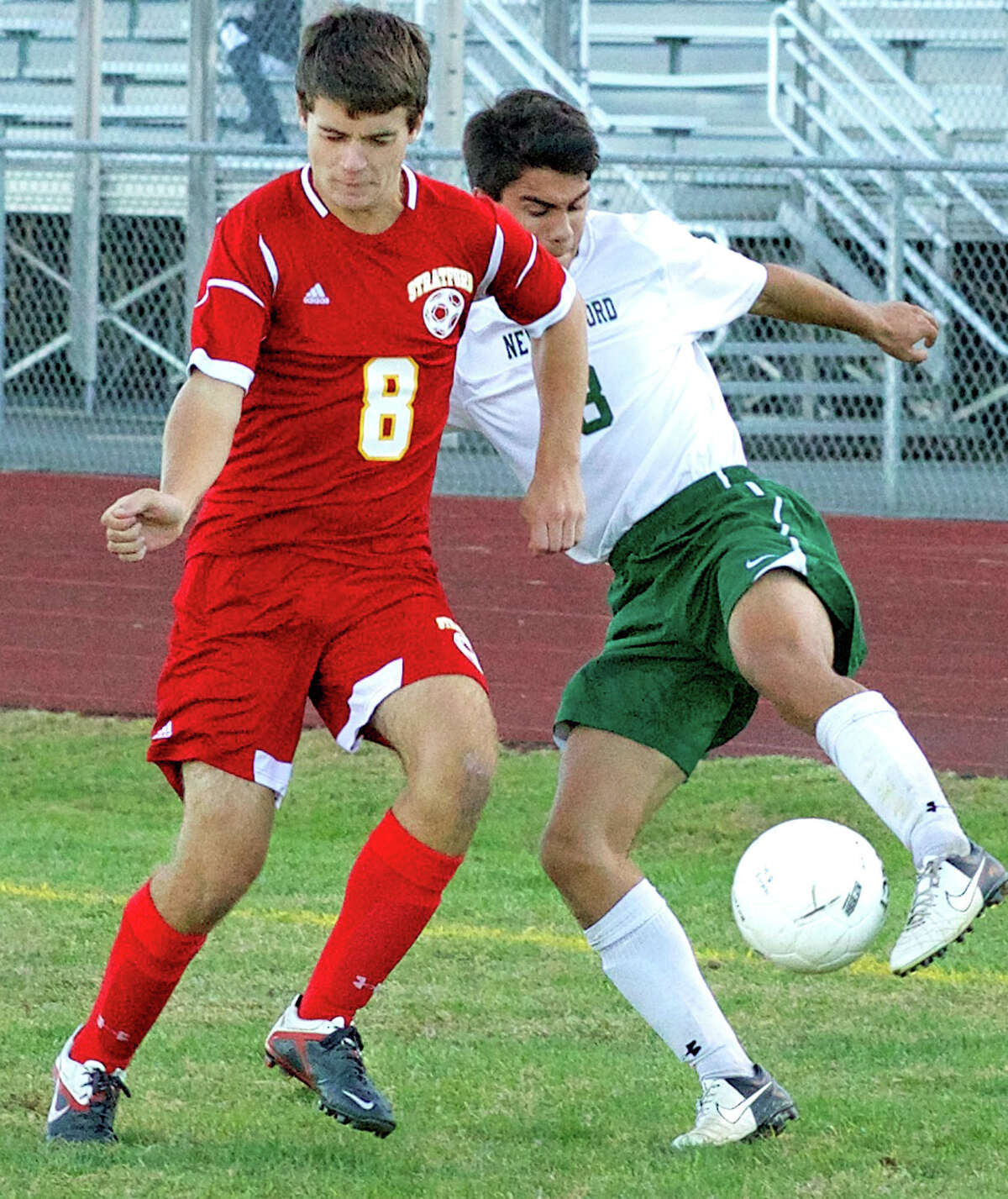 The Green Wave's Nikolas Stefanatos outduels a rival for possession during New Milford High School boys' soccer's 3-1 victory over Stratford, Sept. 23, 2013 at NMHS.