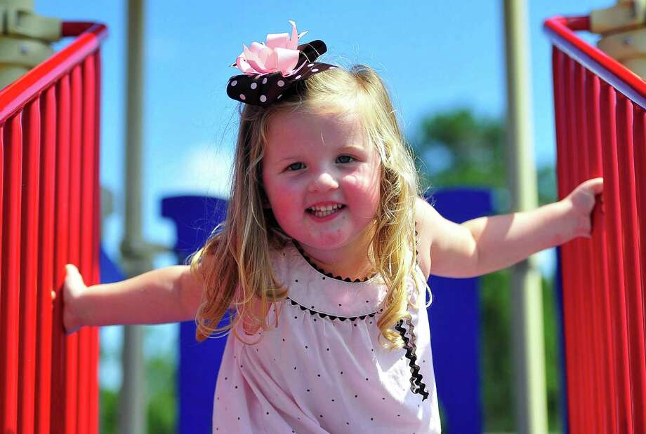 Tessa Williams, 3, of Kountze, plays with her mother, Brandy, on Friday at the park. Photo: Cassie Smith