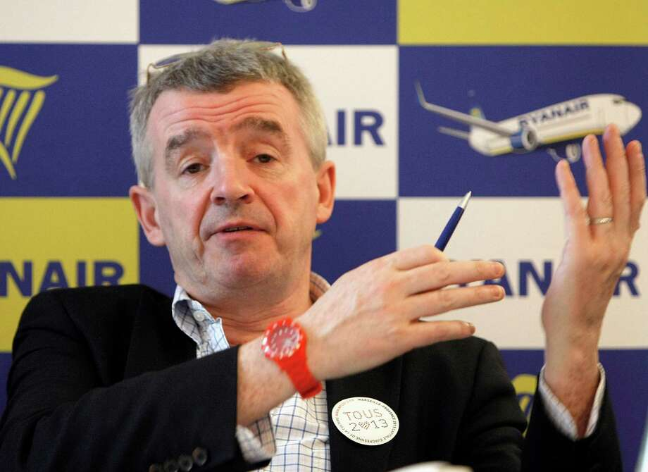FILE - In this Jan.16, 2013 file photo, Ryanair chief executive Michael O'Leary meets the media to present new routes operating by Ryanair from Marseille,  in Vitrolles , southern France. A lawyer for a group of Ryanair's French pilots says Wednesday Oct. 2, 2013,  a court on  has fined  the Irish airline 200,000 euros ($270,440) and ordered it to pay almost 8 million euros ($10.8 million) in damages and interest for breaking French labor law. (AP Photo/Claude Paris, File) ORG XMIT: PAR105 Photo: Claude Paris / AP