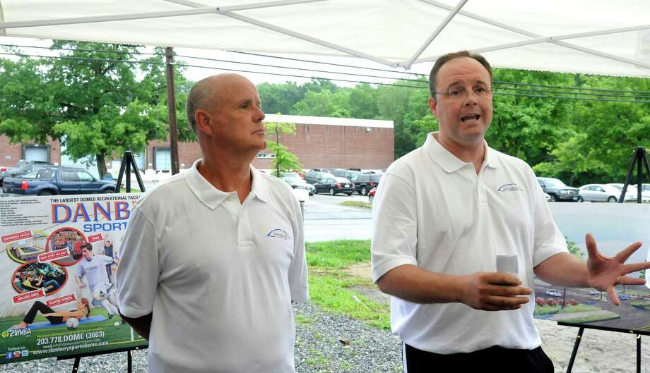 Ray Franklin, left, and Kirk Bamford, who will manage day-to-day activities of the new Danbury Sports Dome, speak during the groundbreaking ceremony Monday, June 25, 2012. Photo: Michael Duffy / The News-Times