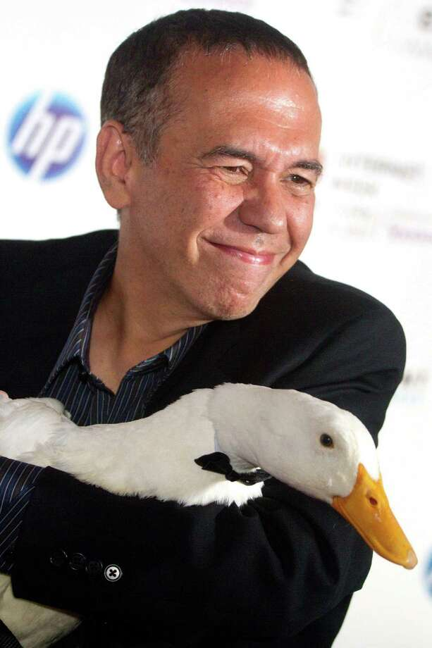 FILE - In this June 14, 2010 file photo, Gilbert Gottfried arrives with the Aflac duck to the 14th Annual Webby Awards in New York. Aflac on Monday, March 14, 2011 announced that it has severed ties with Gottfried over jokes about the earthquake and tsunami in Japan that the comedian posted on Twitter. (AP Photo/Charles Sykes, File) Photo: Charles Sykes / AP2010