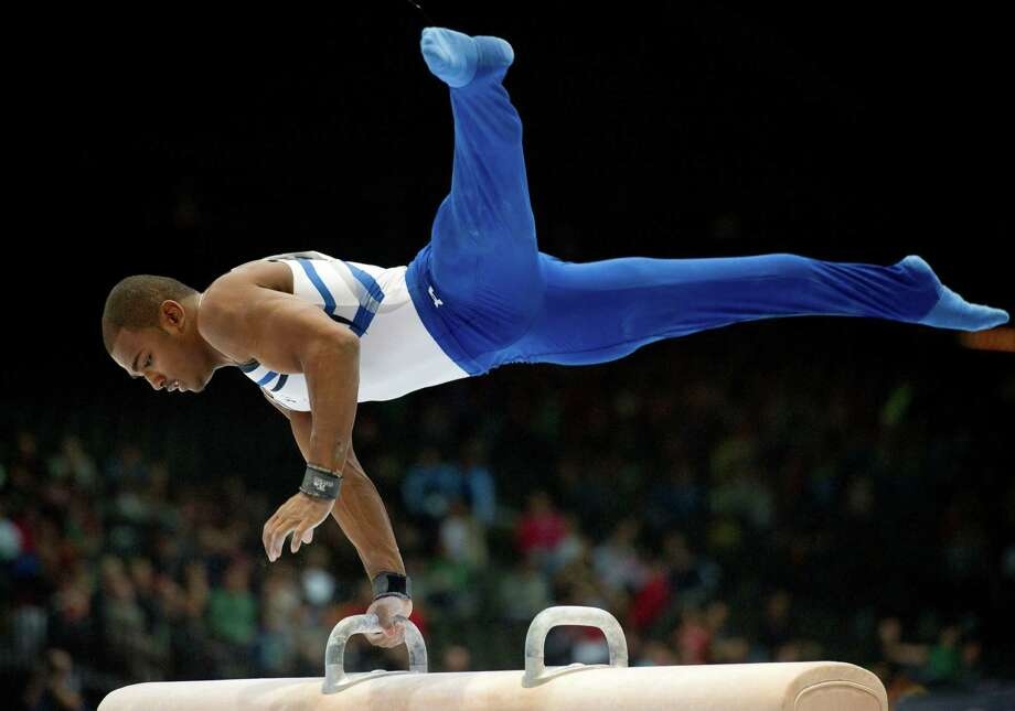 United States John Orozco competes on the pommel horse during a qualification session at the Artistic Gymnastics World Championships in Antwerp, Belgium on Tuesday, Oct. 1, 2013. The event will take place until Sunday, Oct. 6. Photo: Associated Press