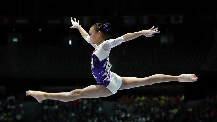 China's Zeng Siqi competes on the balance beam during a qualification session at the Artistic Gymnastics World Championships in Antwerp, Belgium, Tuesday, Oct. 1, 2013. The event will take place until Sunday, Oct. 6. (AP Photo/Virginia Mayo) Photo: Associated Press