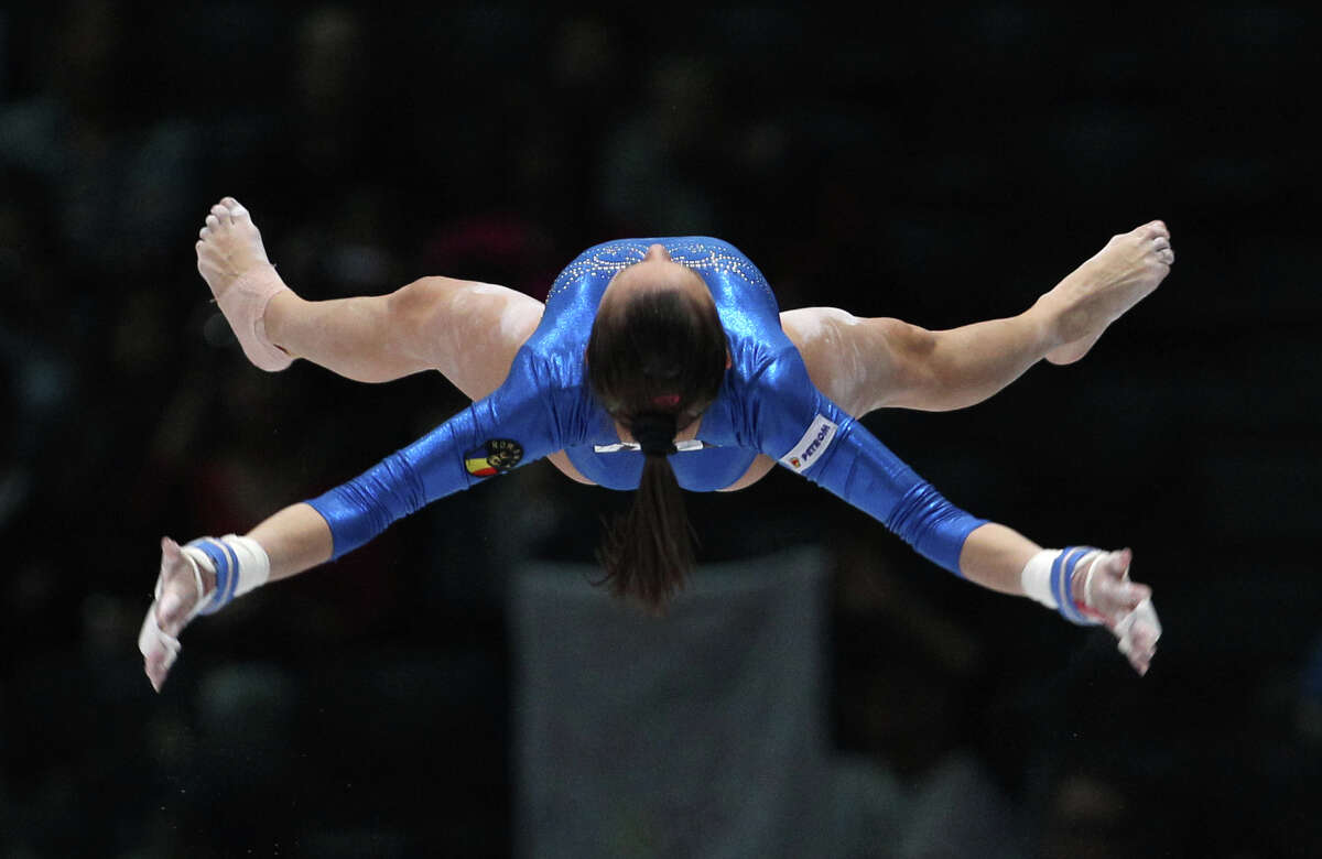 Larisa Andreea Iordache from Romania performs on the uneven bars, during the qualification round at the artistic gymnastics World Championships in Antwerp, Belgium, Wednesday, Oct. 2, 2013. The event takes place until Sunday, Oct. 6.