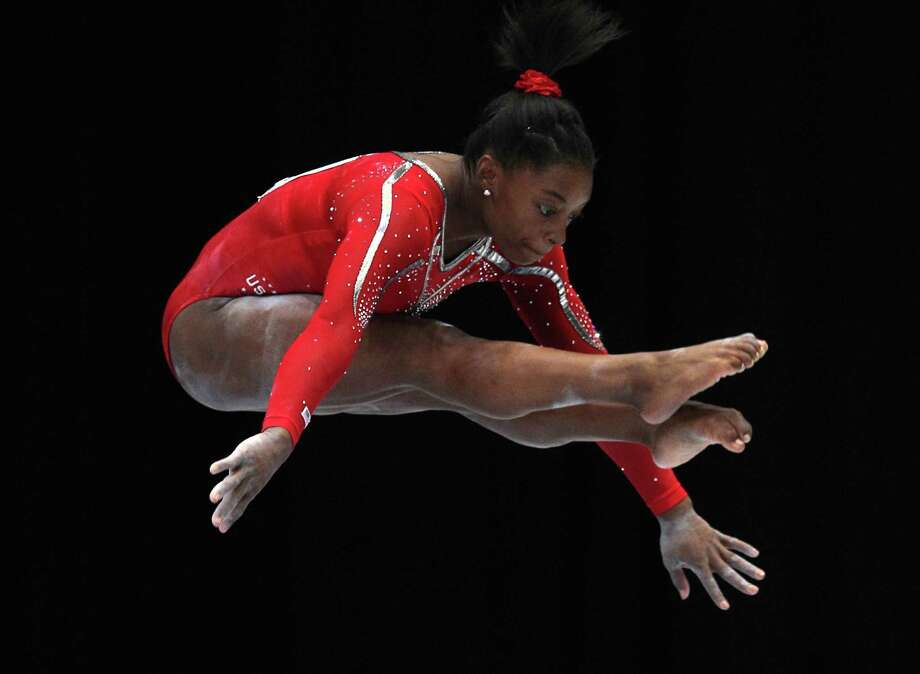 Simone Biles from the U.S. performs on the balance beam, during the qualification round at the artistic gymnastics World Championships in Antwerp, Belgium, Wednesday, Oct. 2, 2013. The event takes place until Sunday, Oct. 6. Photo: Associated Press