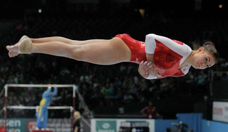 Elisa Haemmerle from Austria performs on the balance beam, during the qualification round at the artistic gymnastics World Championships in Antwerp, Belgium, Wednesday, Oct. 2, 2013. The event takes place until Sunday, Oct. 6. Photo: Associated Press