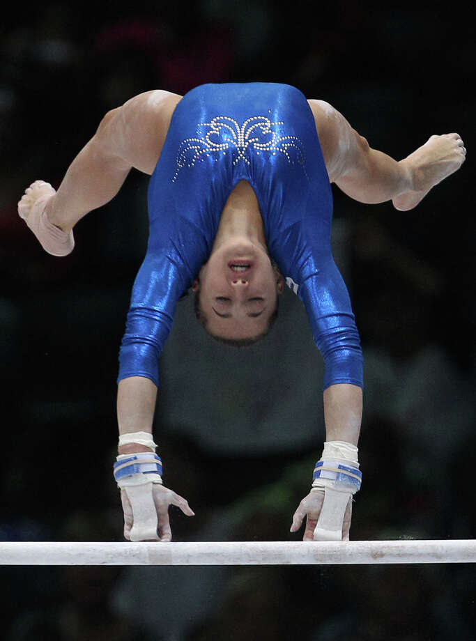 Larisa Andreea Iordache from Romania performs on the uneven bars, during the qualification round at the artistic gymnastics World Championships in Antwerp, Belgium, Wednesday, Oct. 2, 2013. The event takes place until Sunday, Oct. 6. Photo: Associated Press