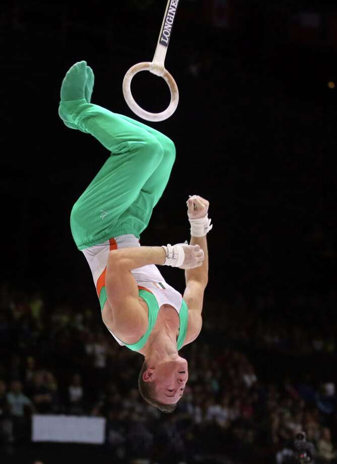 Ireland's Christopher O'Connor dismounts from the rings during a qualification session at the Artistic Gymnastics World Championships in Antwerp, Belgium on Monday, Sept. 30, 2013. The event will take place from Monday, Sept. 30 until Sunday, Oct. 6. Photo: Associated Press