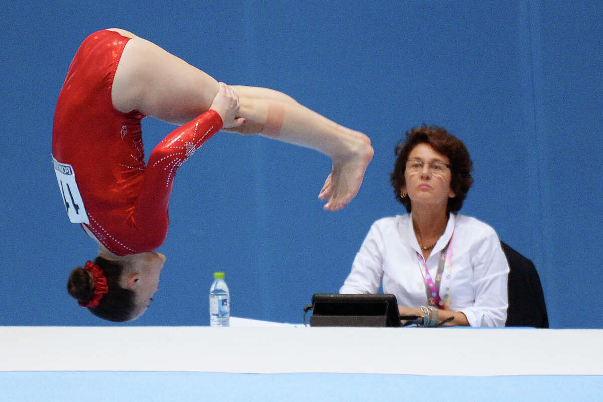 Canada's Chant Maegan competes in the floor exercise during a qualification session at the Artistic Gymnastics World Championships in Antwerp, Belgium on Tuesday, Oct. 1, 2013. The event will take place until Sunday, Oct. 6.