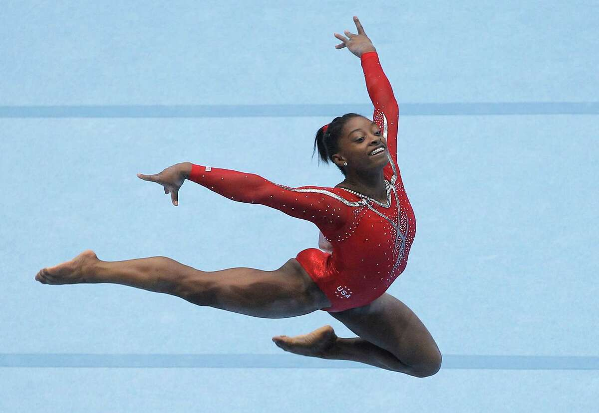 Simone Biles from the U.S. performs on the floor, during the qualification round at the artistic gymnastics World Championships in Antwerp, Belgium, Wednesday, Oct. 2, 2013. The event takes place until Sunday, Oct. 6.