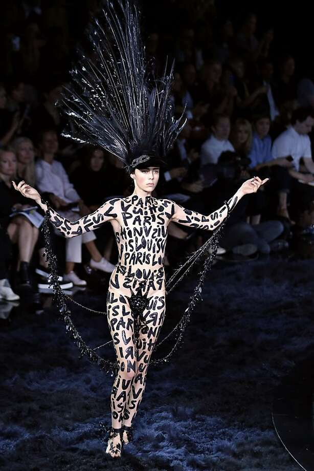 Fashion markup:Is model Edie Campbell wearing a bodysuit or just paint to go along with her elaborate headpiece during the 2014 Spring/Summer ready-to-wear collection show in Paris? It's hard to tell. Photo: Joel Saget, AFP/Getty Images